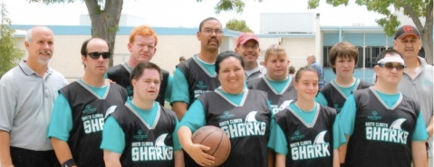 The Santa Clarita Sharks at the Antelope Valley Special Olympic Basketball Tournament. <p> Lorne is wearing the red cap in the back row.